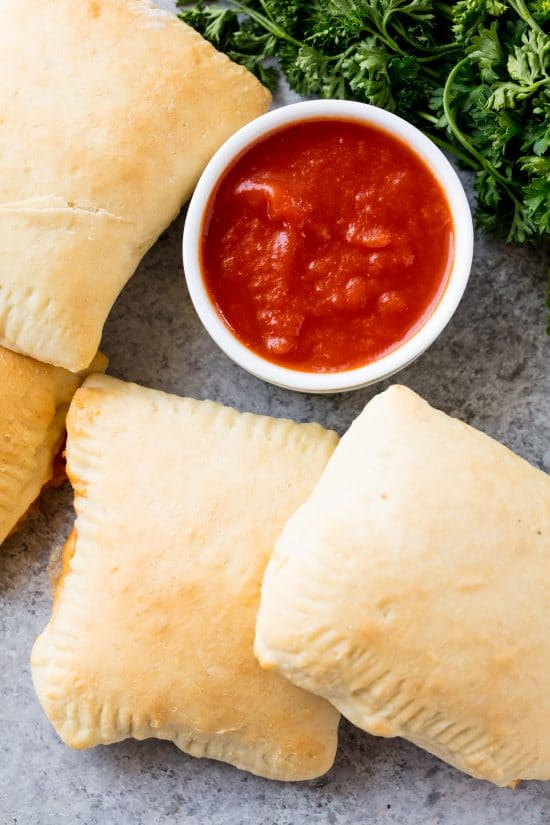 Homemade Hot Pockets are an easy homemade freezable lunch idea. They are perfect for an on-the-go meal, as well as to put in lunch boxes. The flavor combinations are endless!