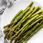 A stack of Roasted Asparagus on a plate
