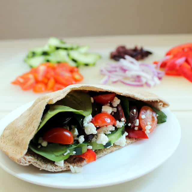 Greek Pita stuffed with cheese, tomato, onion, and other vegetables.