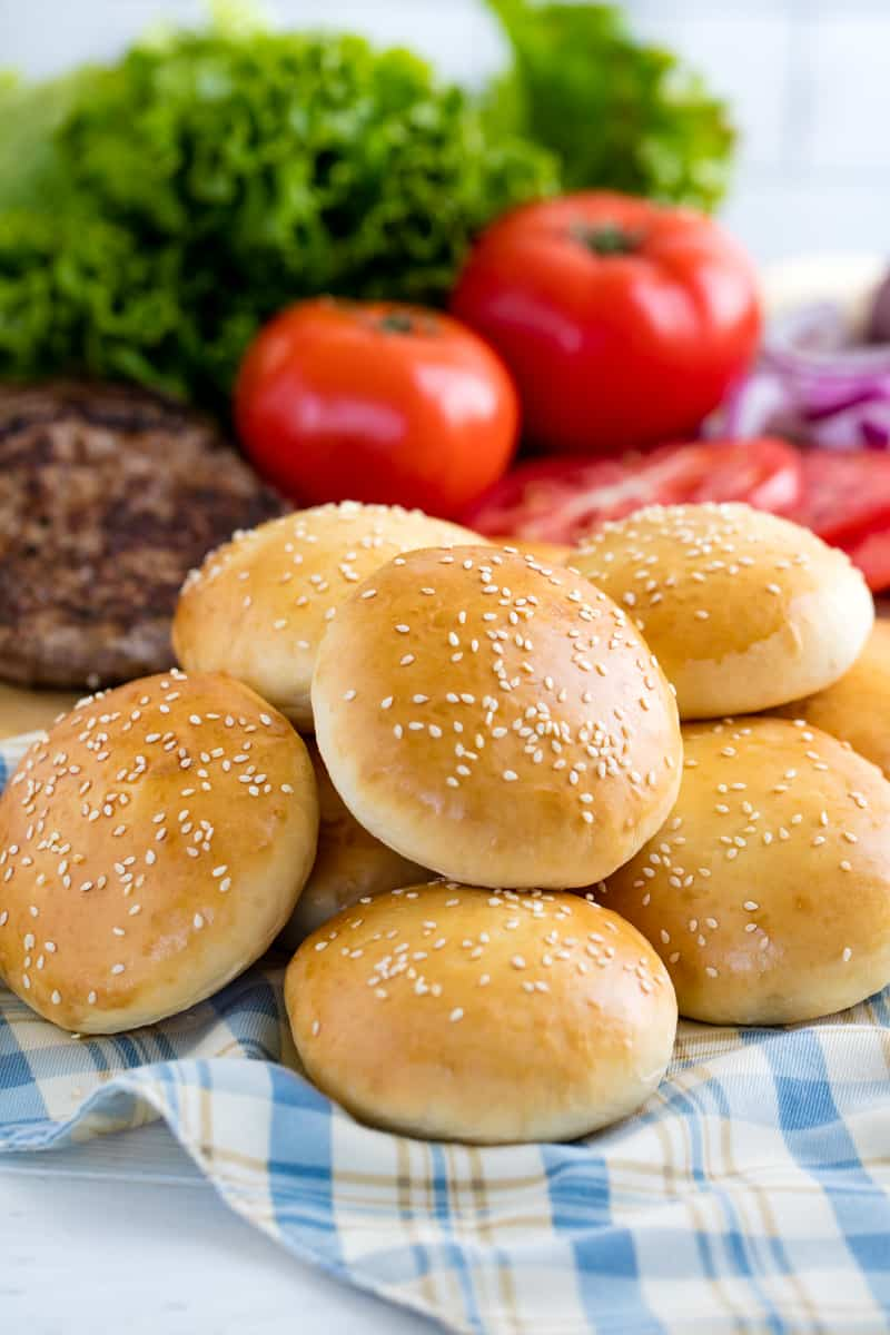 Stack of hamburger buns on a cloth.