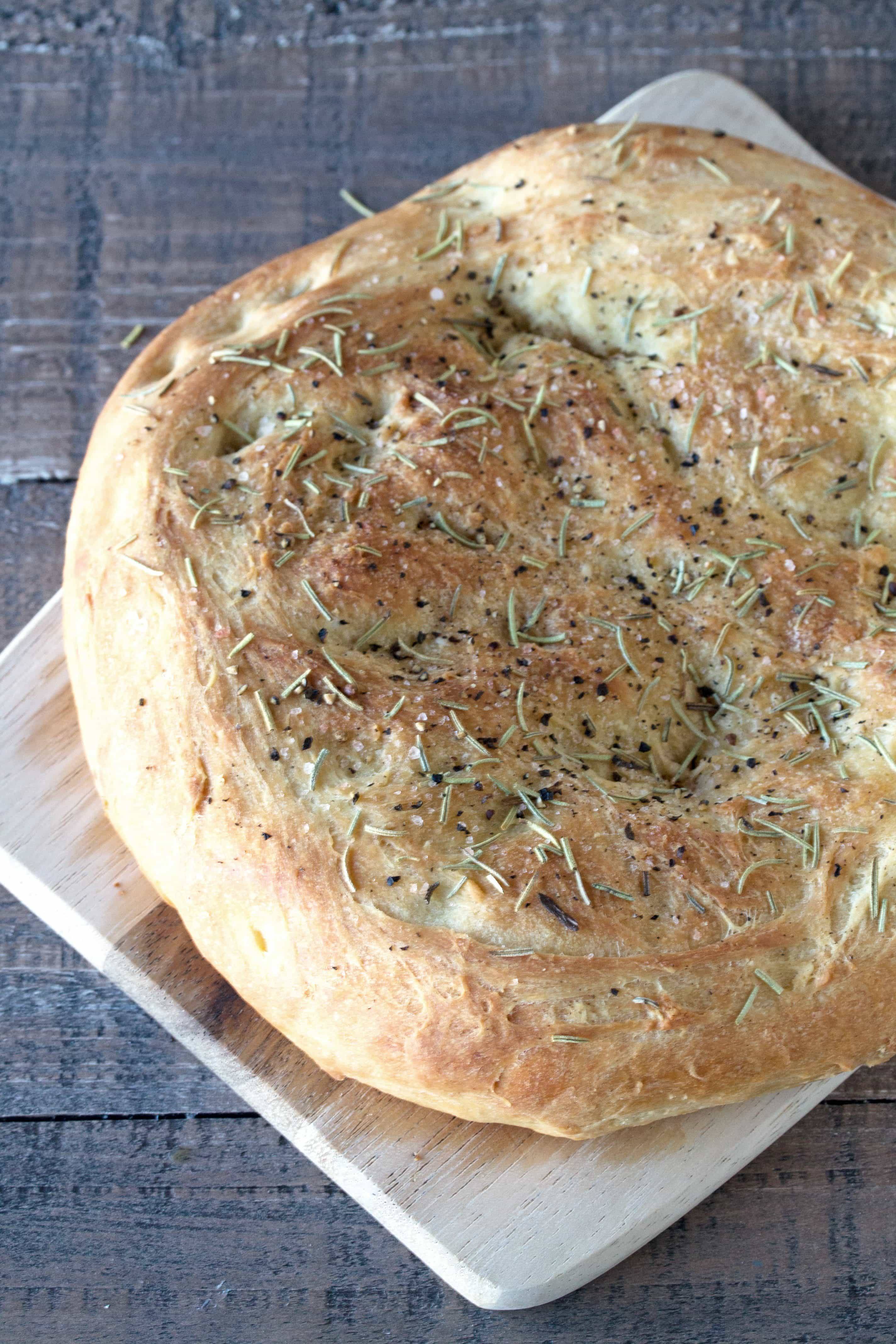 Easy Homemade Rosemary Focaccia makes the most delicious sandwiches and is heavenly along side a bowl of soup. You are going to fall in love and make this all year long!
