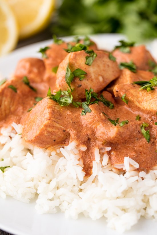 Chicken Tikka Masala on rice sprinkled with cilantro