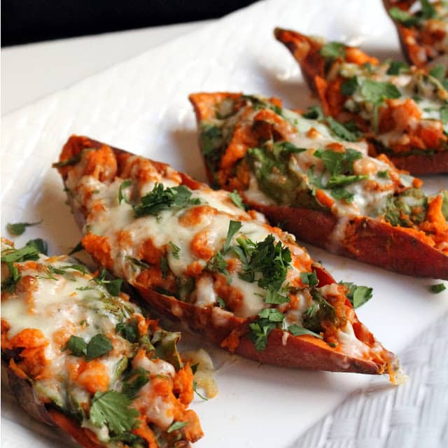 Chipotle Twice Baked Sweet Potatoes are sweet, smokey, and a little bit spicy. This tasty dish can be served up as a vegetarian main course, intriguing side dish, or even a fun appetizer.
