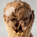 Close up of Chocolate Peanut Butter Banana healthy ice cream in a waffle cone.