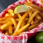 Baked french fries with a spicy chili-lime coating. These Baked Chili-Lime French Fries bring a little heat and a whole lot of flavor!