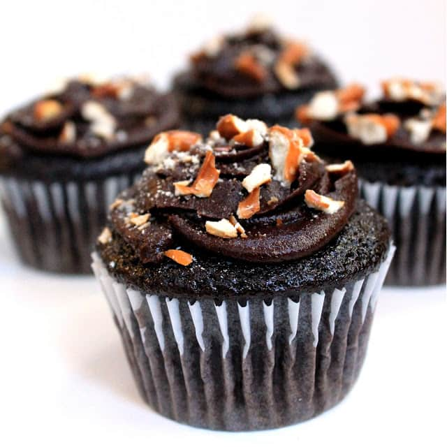 Sinfully decadent chocolate cupcakes filled with a creamy peanut butter filling and topped with whipped chocolate ganache and crushed pretzel.