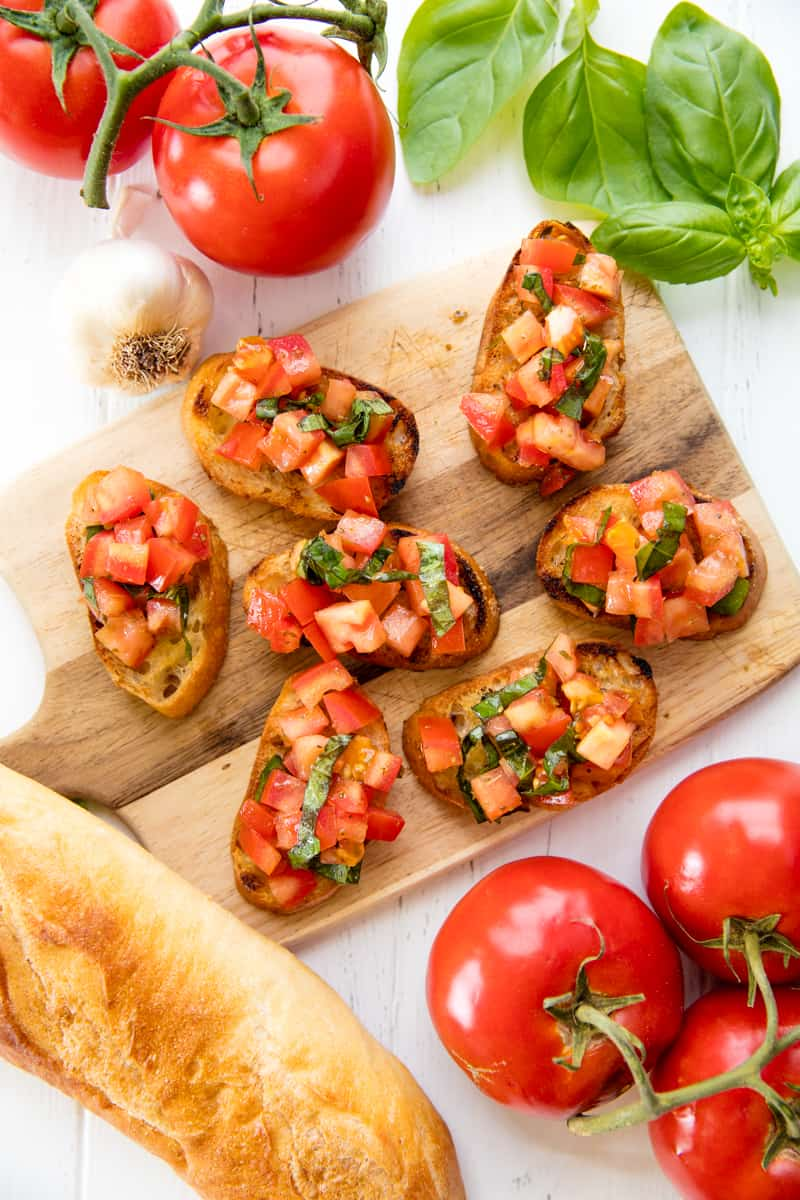 Bird's eye view of Bruschetta on a cutting board.