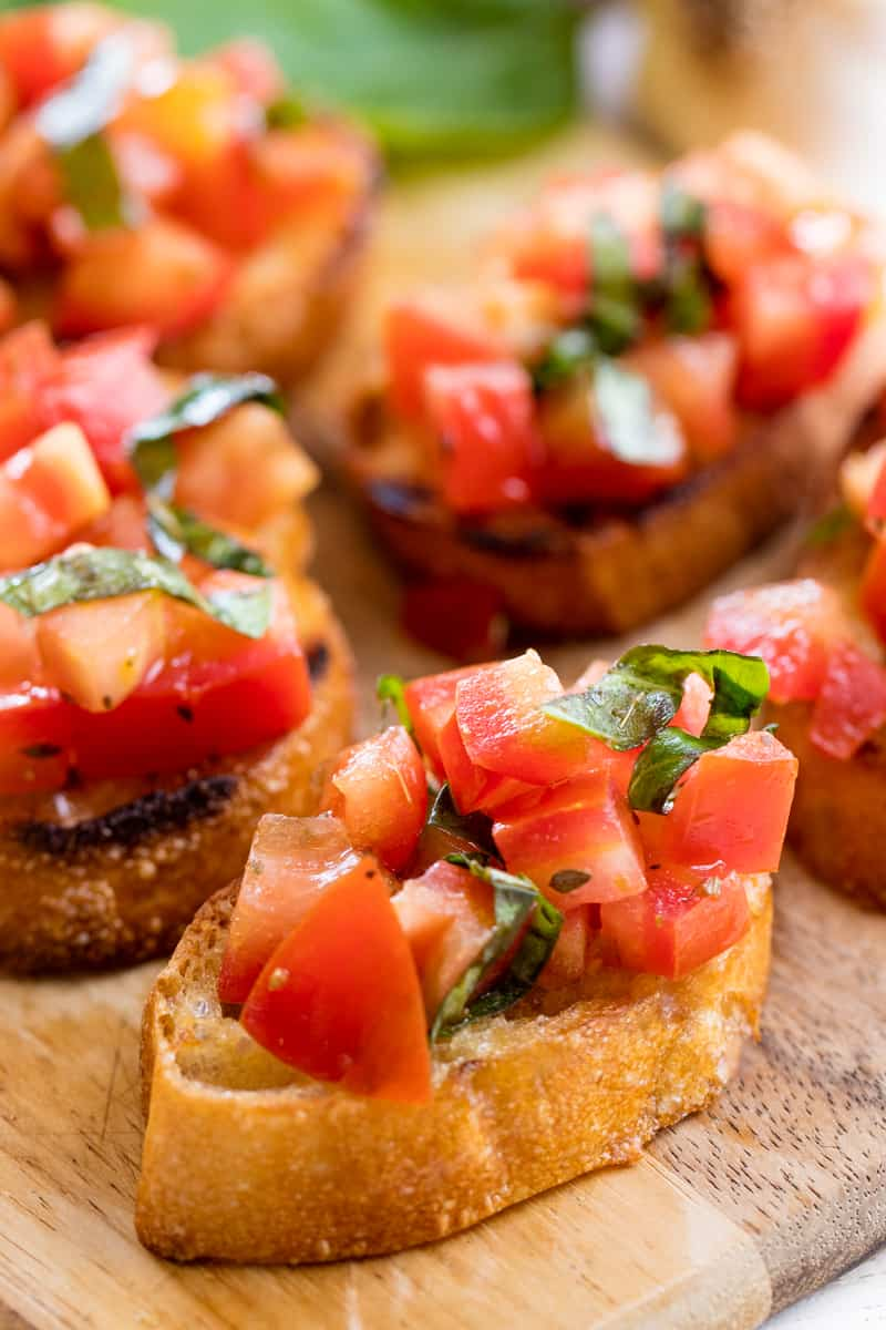 Clsoe up of Bruschetta on a cutting board.