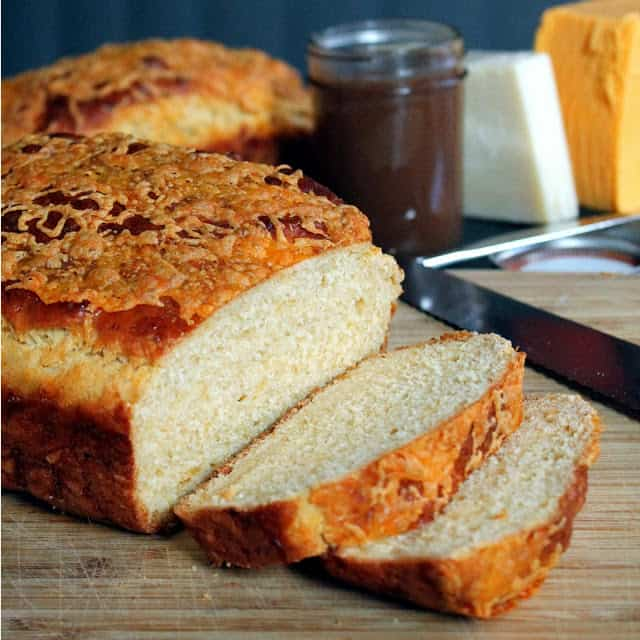 Cheddar Batter Bread with two slices taken out of it.