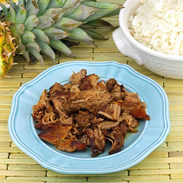 Kalua pork on a blue plate.