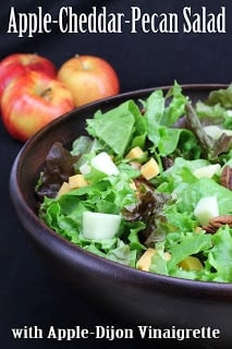 Close up of Apple cheddar salad in a black bowl.