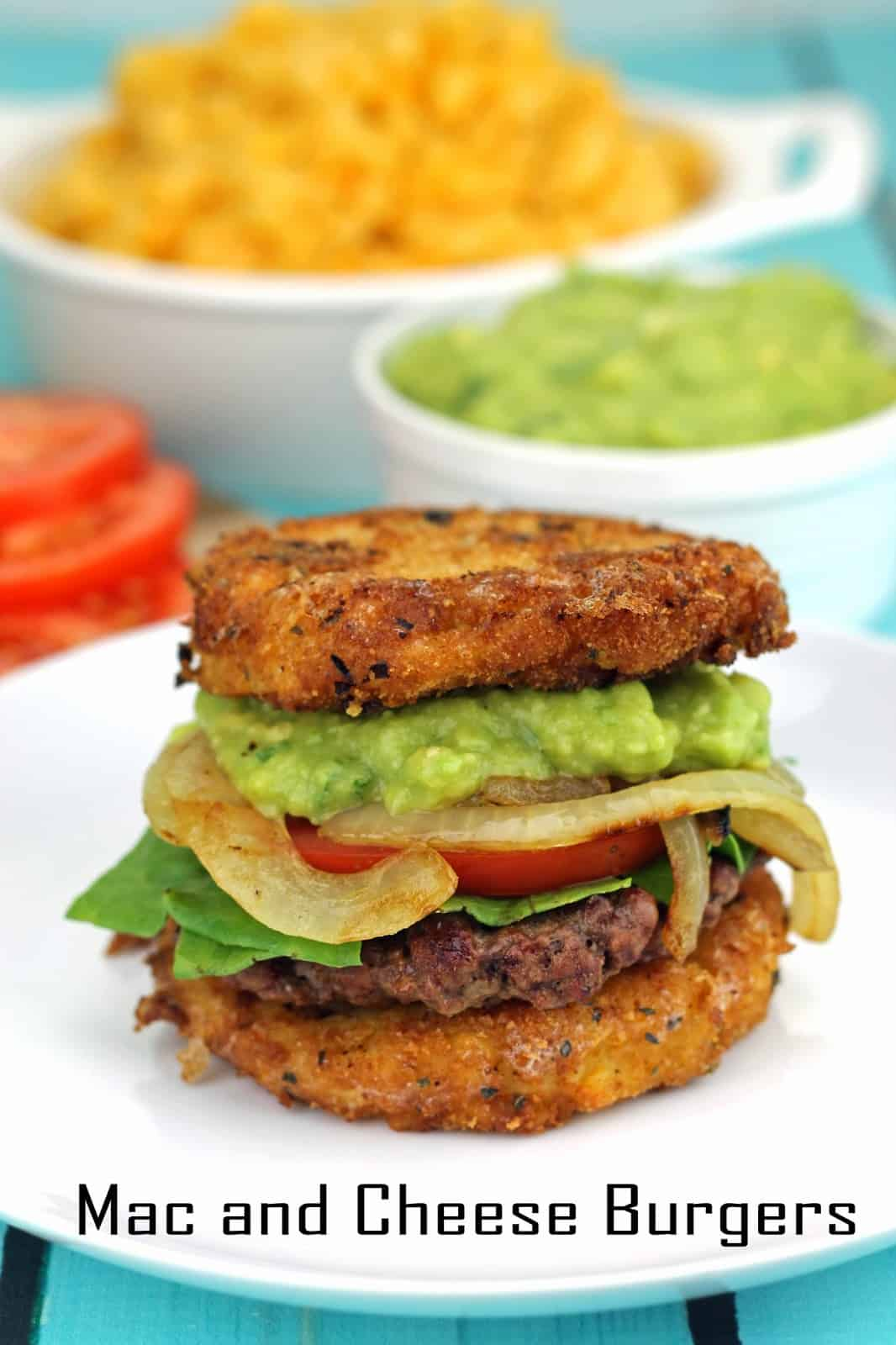 Mac and Cheese Burgers with Guacamole and Grilled Onions sitting on a white plate.
