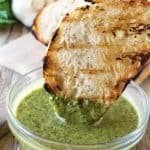 Smokey grilled bread dipped in ultra flavorful chimichurri sauce. Grilled Bread and Chimichurri Sauce is a match made in heaven!