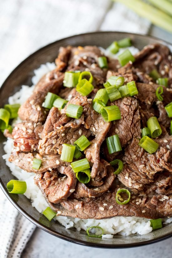 Korean Beef Bulgogi over rice topped with sesame seeds and chopped green onion