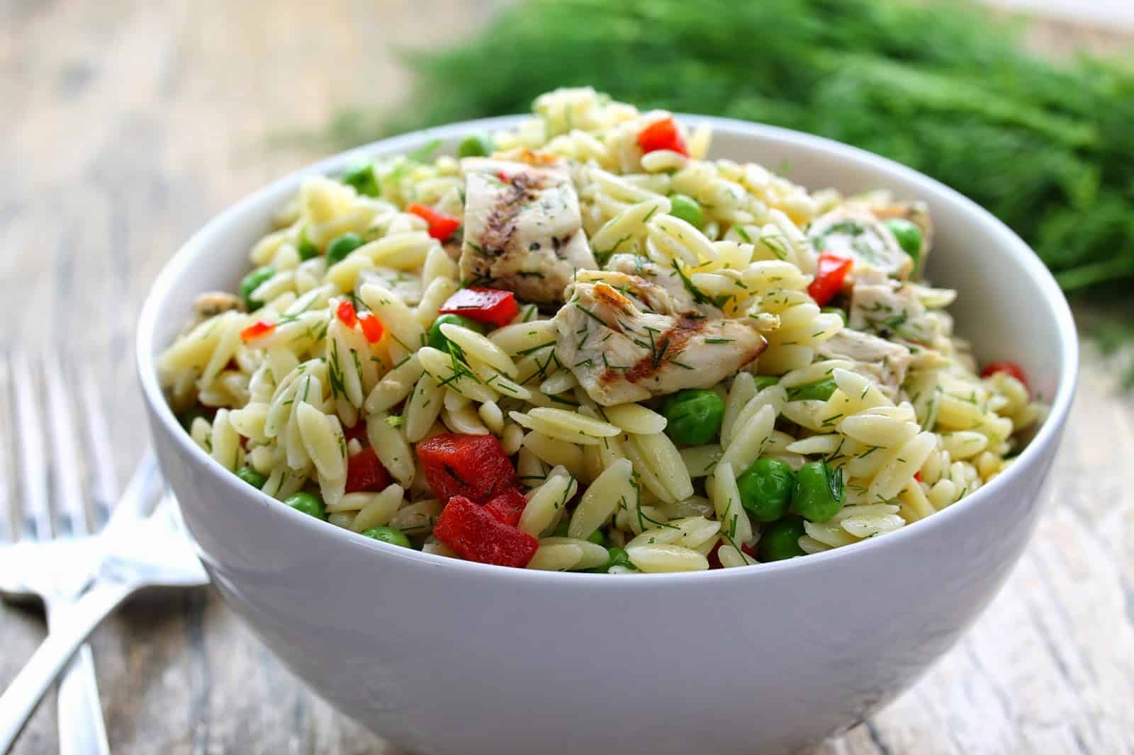 Lemon-Dill Chicken and Orzo Pasta Salad in a white bowl.