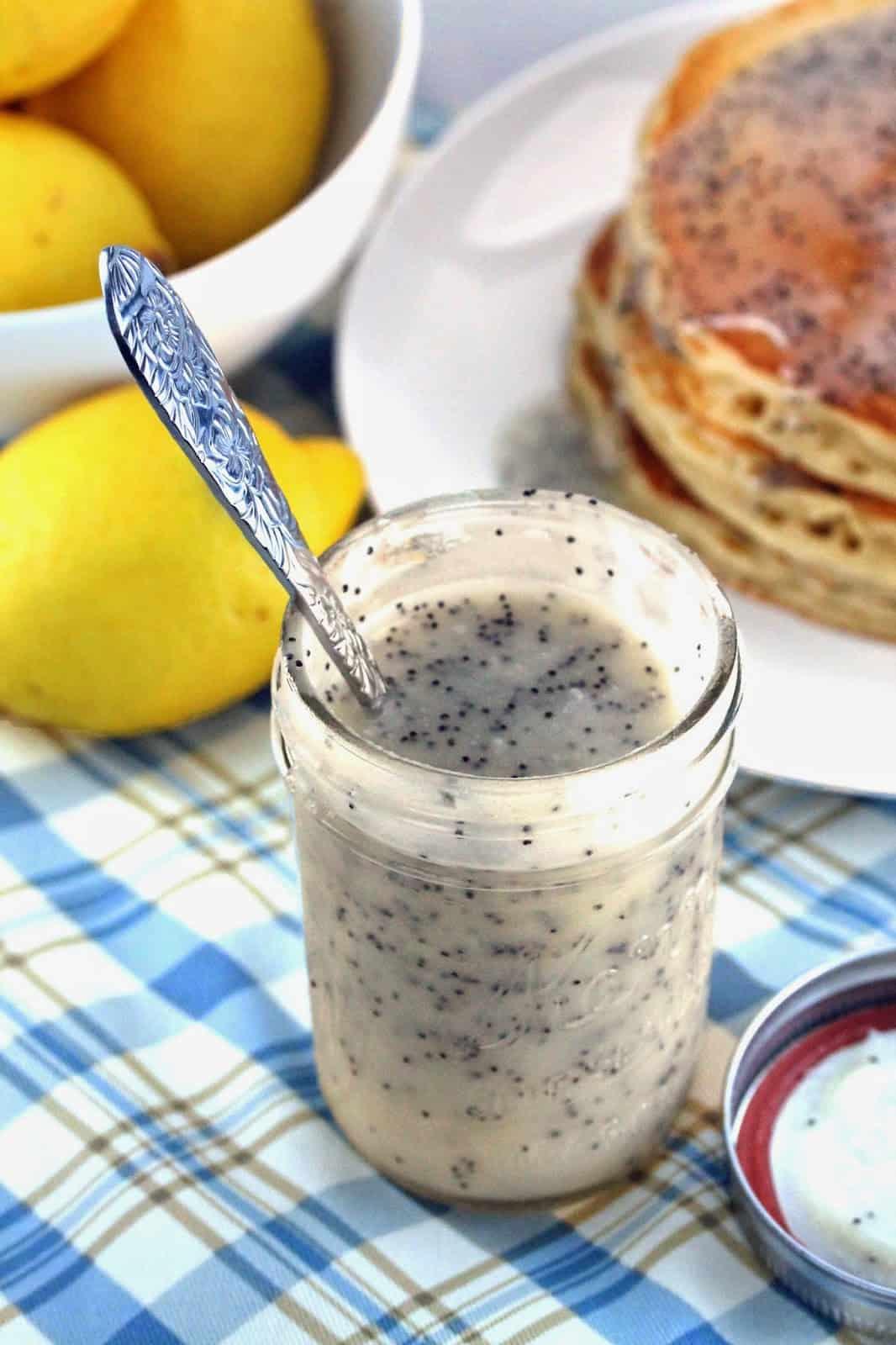 Lemon poppyseed buttermilk syrup in a mason jar with spoon in jar
