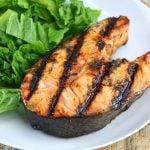 orange ginger grilled salmon steak next to salad