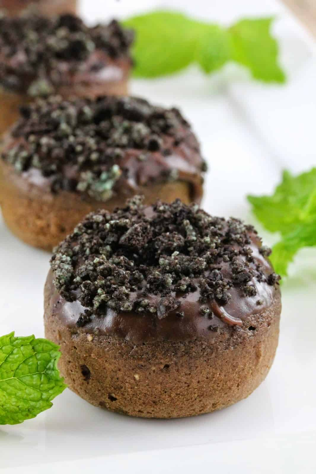 Baked chocolate donuts with mint frosting