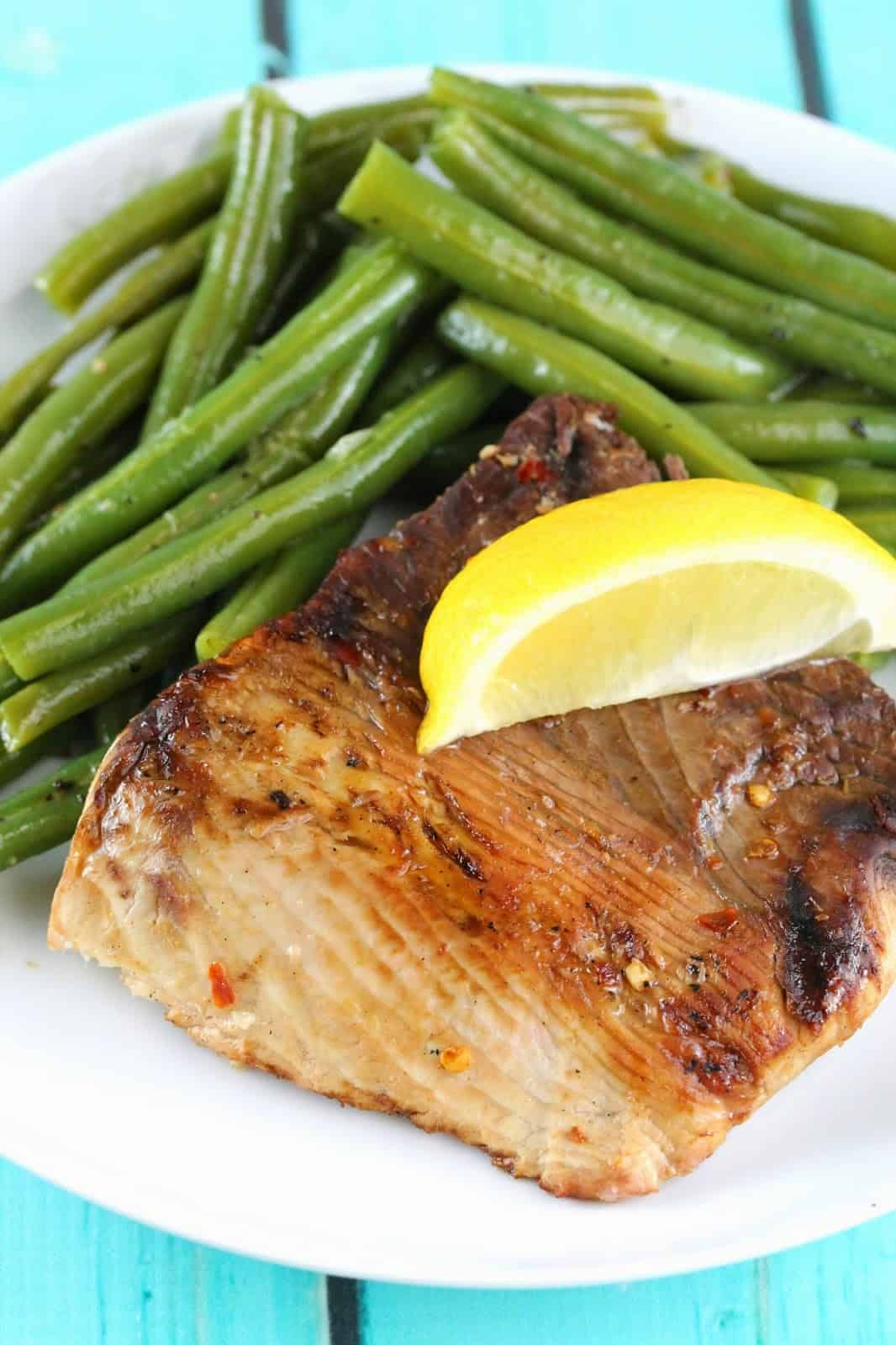 Thresher Shark served with green beans and topped with a fresh lemon wedge: A nice, steaky, meaty fish that makes you feel like you have conquered the ocean.