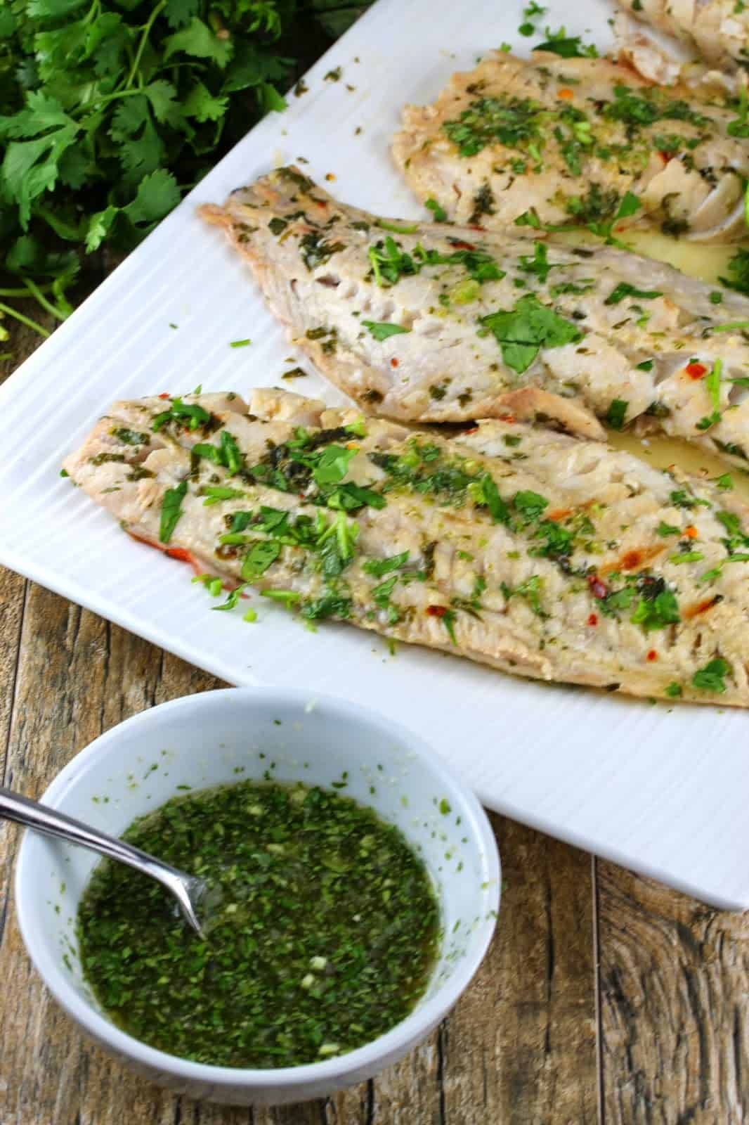 Thai grilled fish with green dipping sauce on the side