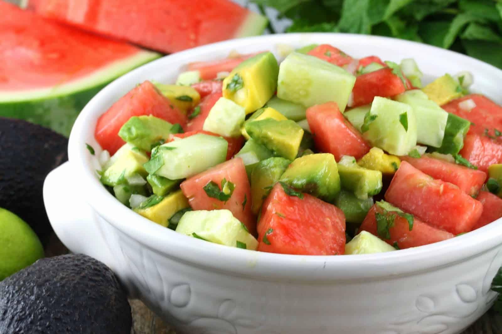 Watermelon, Avocado, Cucumber Salad in a white bowl.