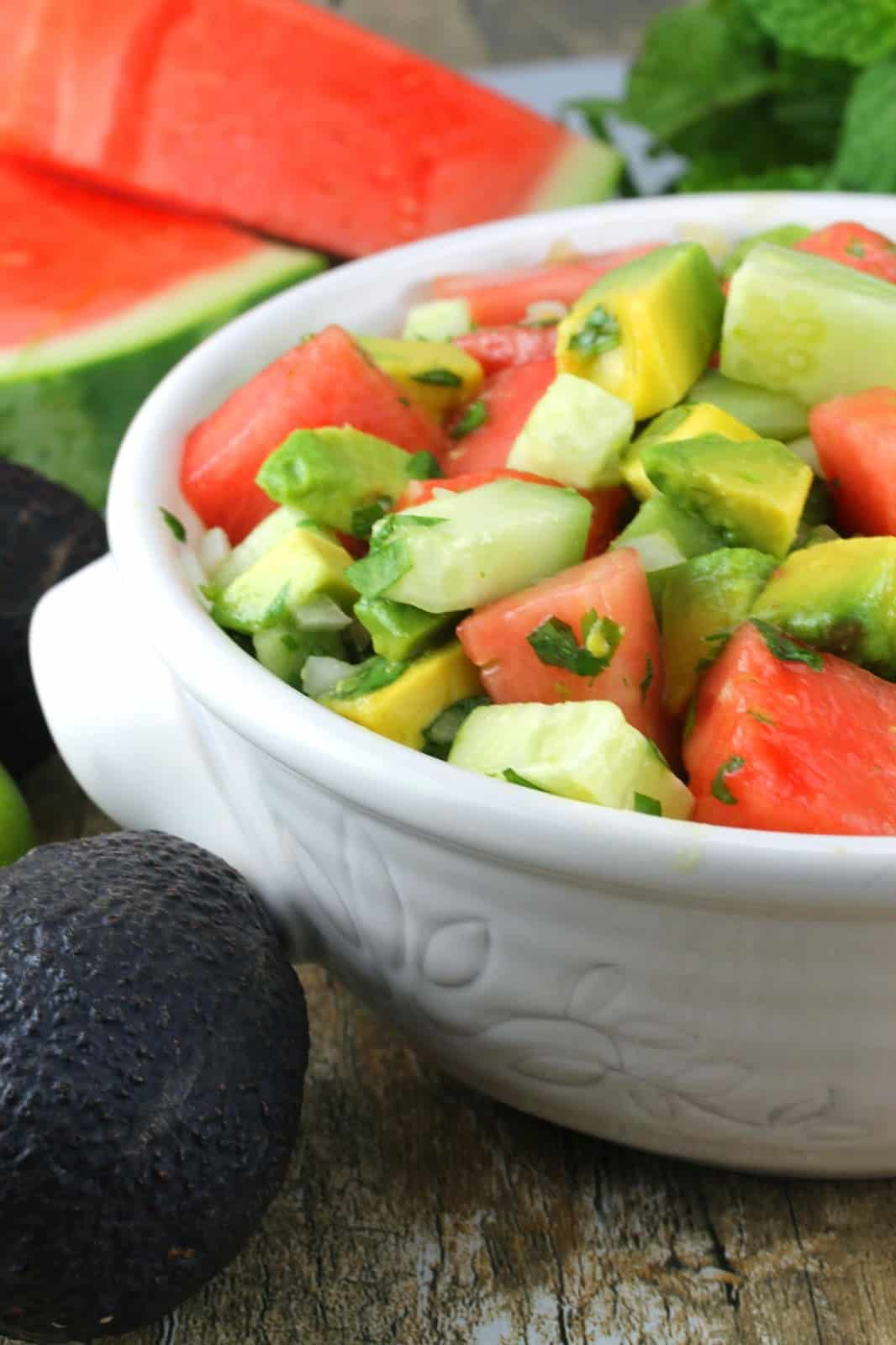 Avocados, cucumber and watermelon are tossed with lime juice and fresh herbs in this light, flavorful, and somewhat adventurous watermelon salad.