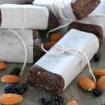 Superfood Protein Energy Bars wrapped in parchment paper and tied with string. These bars are packed with 7 different superfoods!
