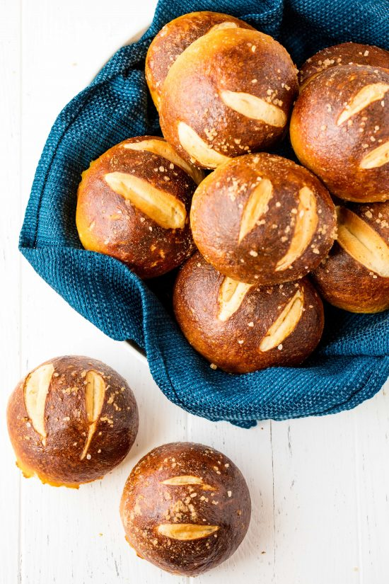Homemade Pretzel Rolls are soft on the inside with a salty, chewy exterior and super easy to make. These rolls will quickly become a family favorite in your house!
