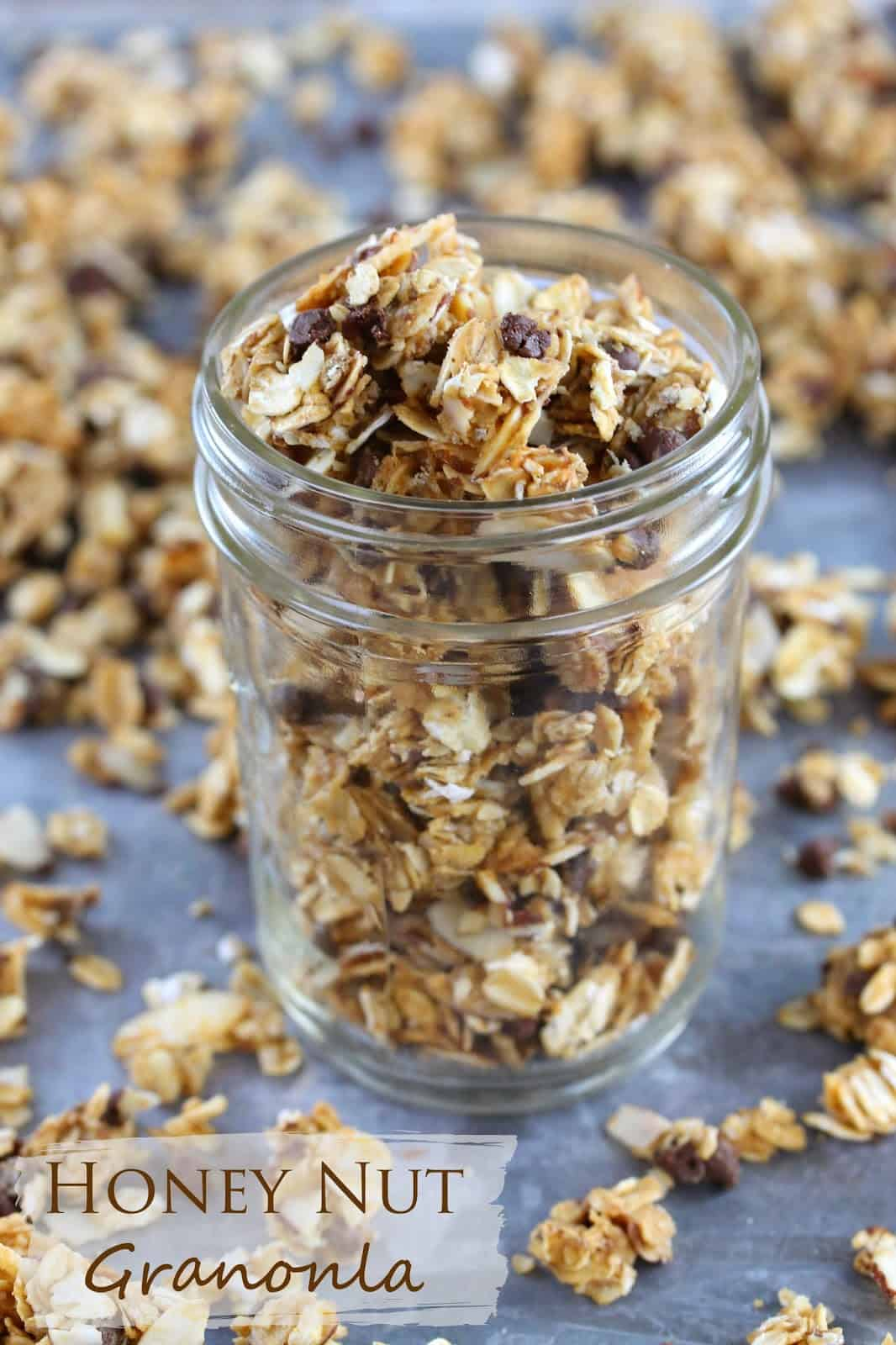 Honey Nut Granola: clusters of granola made from oats, honey, peanut butter, slivered almonds, chocolate chips and other simple ingredients fill a mason jar.