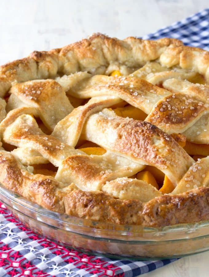 The perfect peach pie is within your grasp. A vibrant, sweet peach filling surrounded by a perfect fail-proof crust. It's all about the secret ingredient.