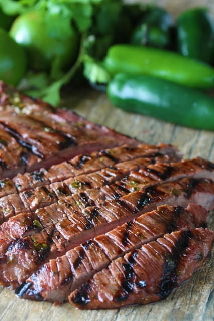 Close up of Carne Asada on a wood countertop.