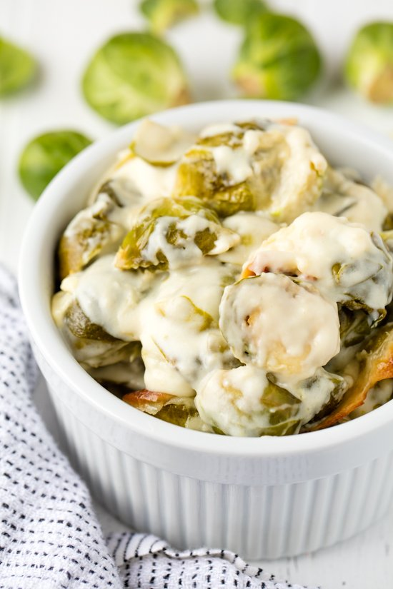 Brussel Sprouts Au Gratin with a creamy au gratin sauce, served in a bowl