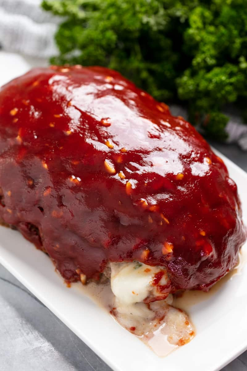 Mozzarella Stuffed Meatloaf on a white plate.