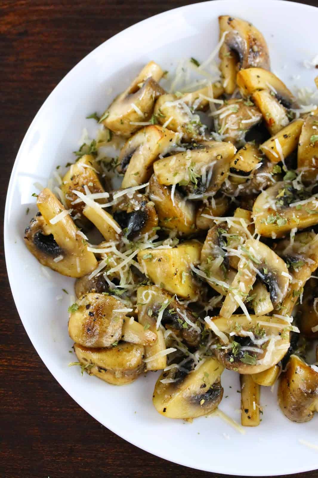 Sauteed Mushrooms with Garlic and Parmesan on a white plate.