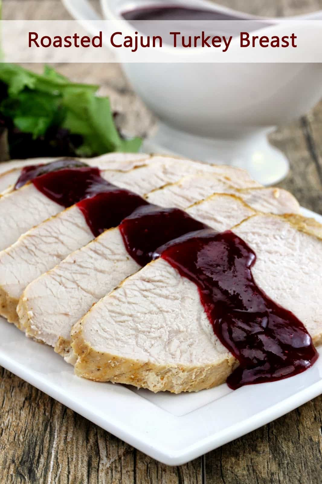 Slices of turkey breast drizzled with cranberry sauce