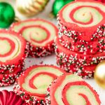A stack of Spiral Christmas Sugar Cookies with swirls of red, green and white and rolled in green, red and white sprinkles