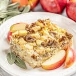 Slice of Sausage Breakfast Strata with Sage and Apple on a white plate.
