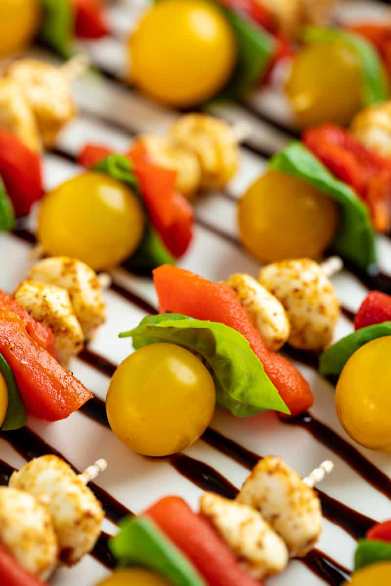 Close up of Southwestern Caprese Bites on a white serving plate.