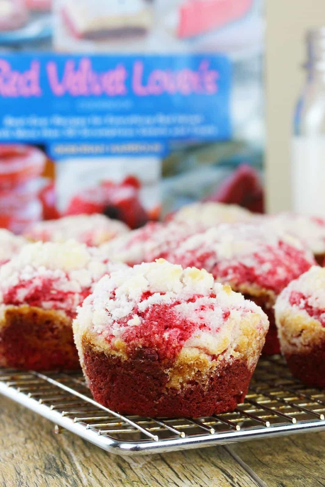 Cream Cheese Muffins from the Red Velvet Lover's Cookbook by Deborah Harroun, resting on a cooling rack