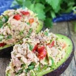 Tuna Stuffed Avocados on a wood countertop.