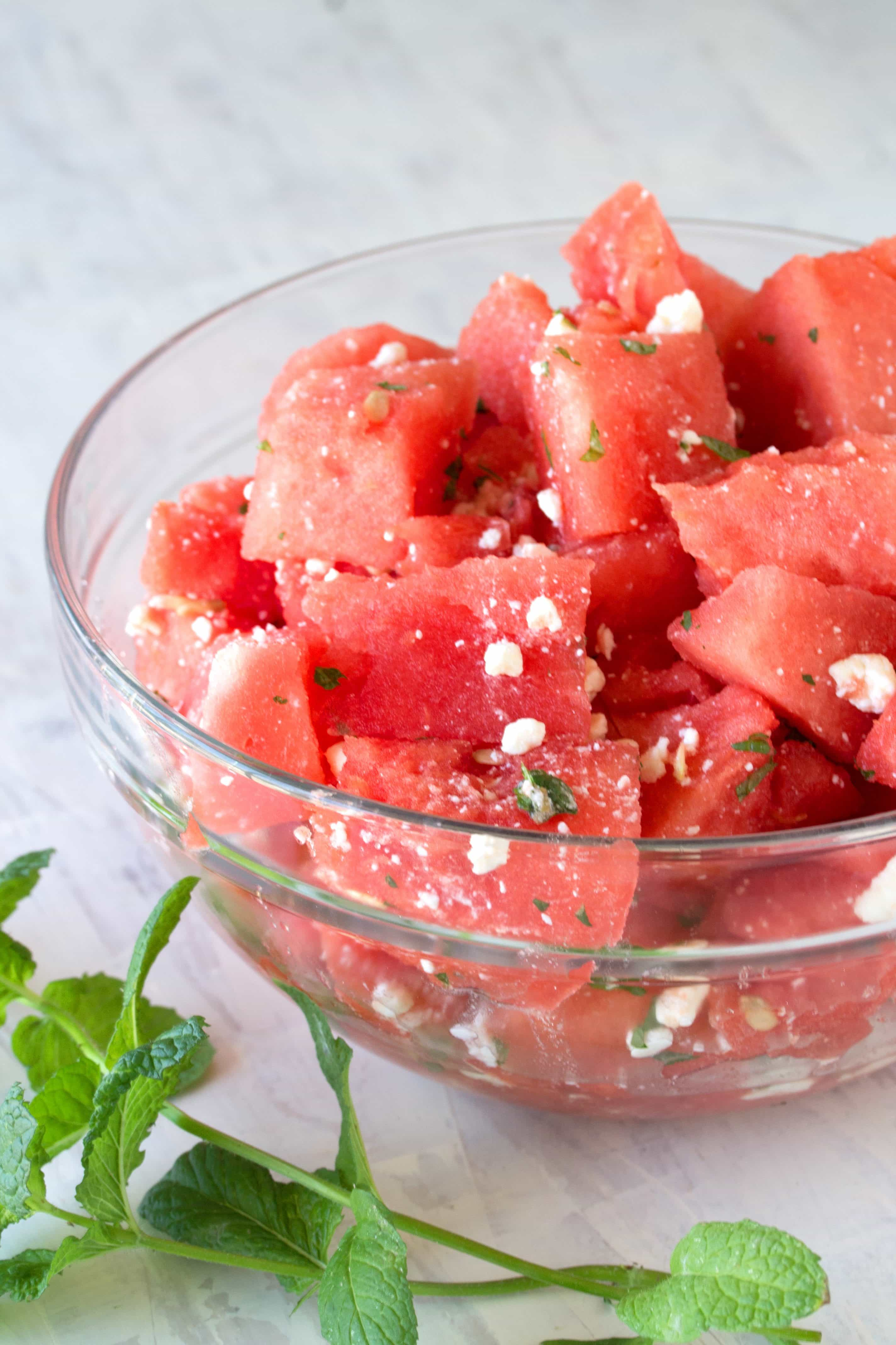 Serve simple summer watermelon up gourmet style with this Watermelon Feta Salad with Mint and Lemon. It's incredibly easy, and oh so tasty!