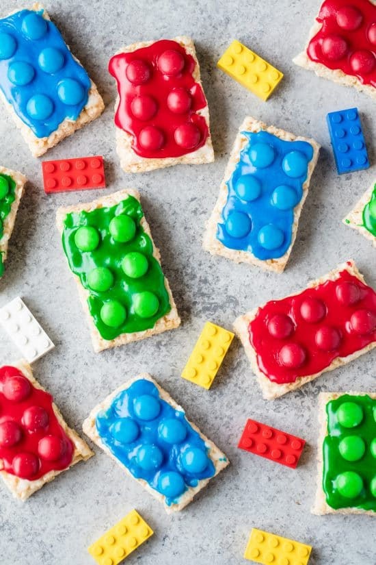 Lego Rice Krispie Treats frosted with various colors and topped with M&Ms to look like toy Legos