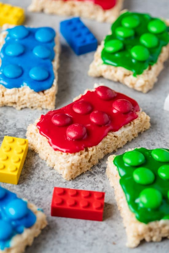Lego Rice Krispie Treats In The Shape Of Toy Legos Frosted With Red Blue