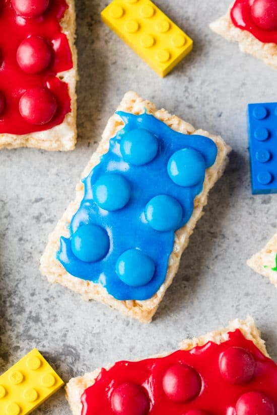 Blue rectangle shaped rice krispie treat, topped with M&Ms that looks like a Lego Rice Krispie Treats
