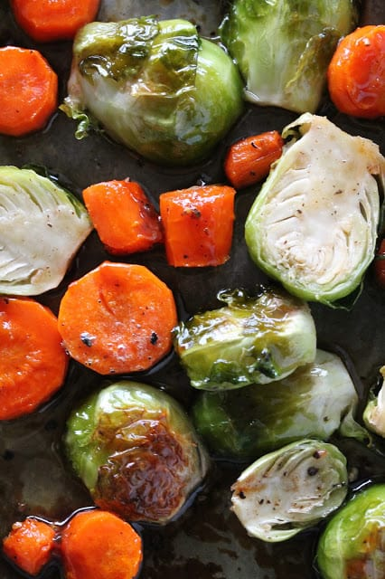Bite sized pieces of roasted Brussel Sprouts and Carrots
