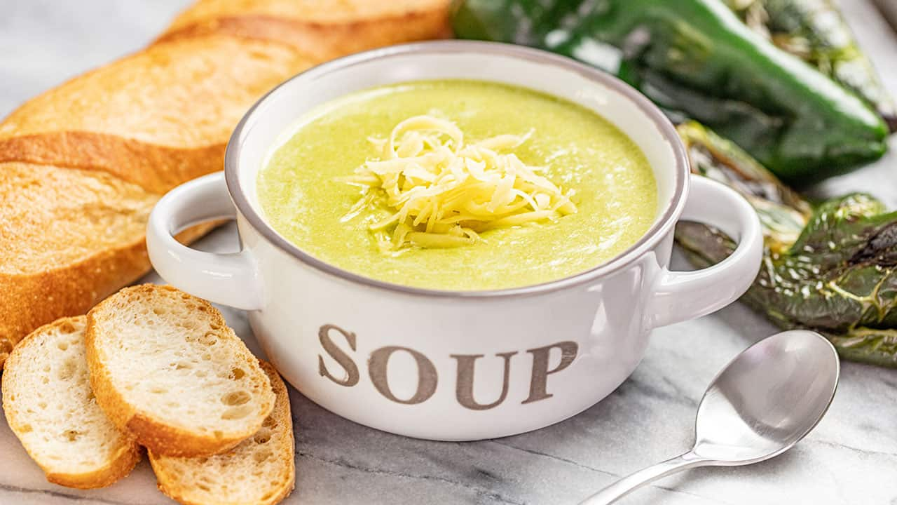 White Cheddar Poblano Soup in a white bowl.