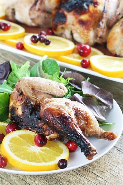 Cornish Hens are a gourmet dinner you can easily make at home.  Cranberry and orange juices are combined in a cran-orange glaze for the little bird, a fantastic combination.