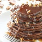 Gingerbread spiced pancakes are smothered with a buttery pecan syrup.