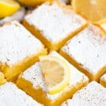 Lemon bars cut into squares.