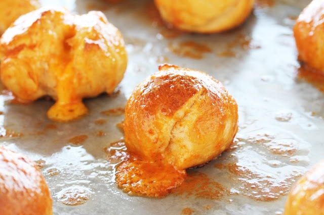 Cheddar Stuffed Sriracha Pretzel Bites are one of the best appetizers ever. It's hard to beat gooey melted cheddar inside a soft and chewy sriracha-flavored pretzel.